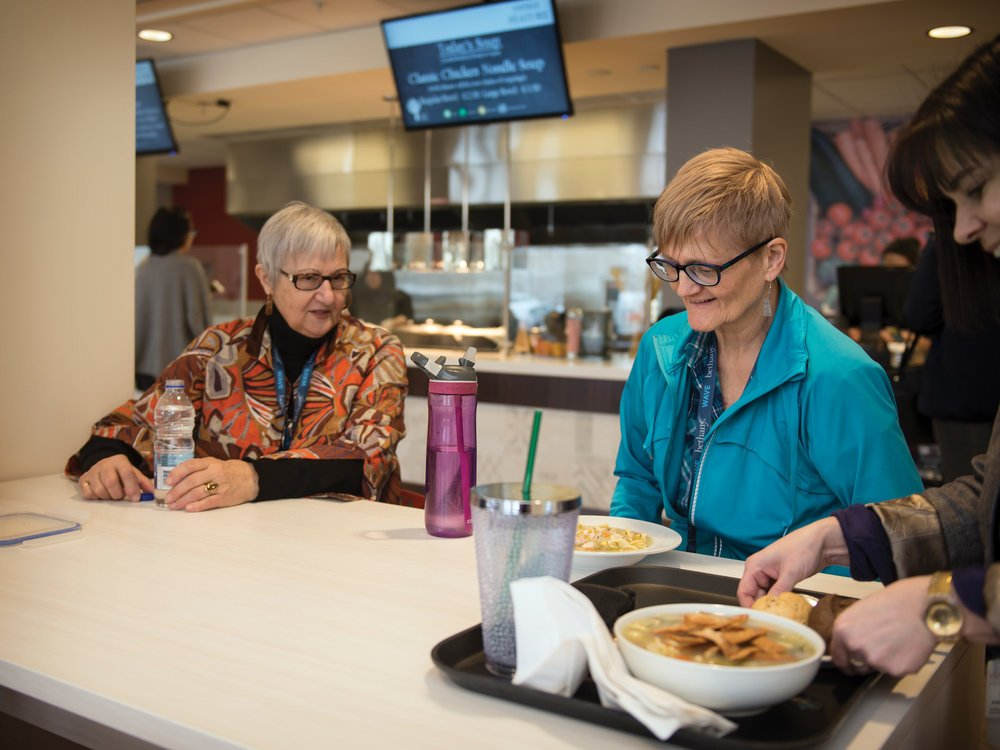 Residents, guests and staff dine together.