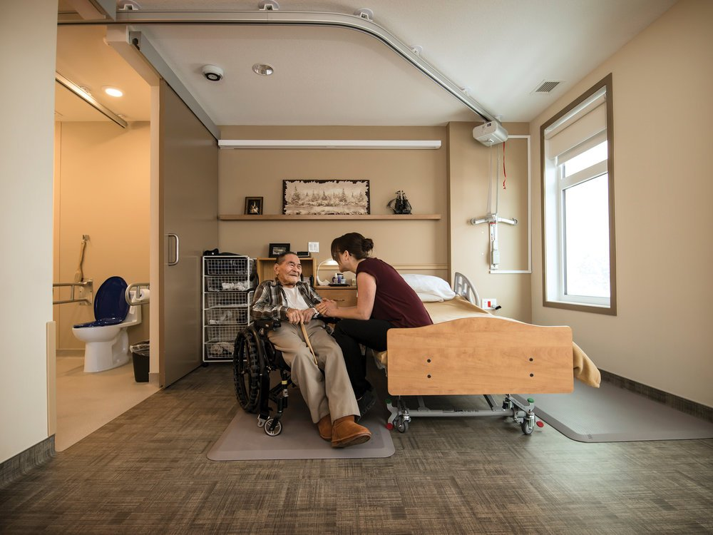 Private, 400-square-foot bedrooms include ensuites with blue toilet seats, which help residents recognize the toilet more easily and note if it is open or closed.