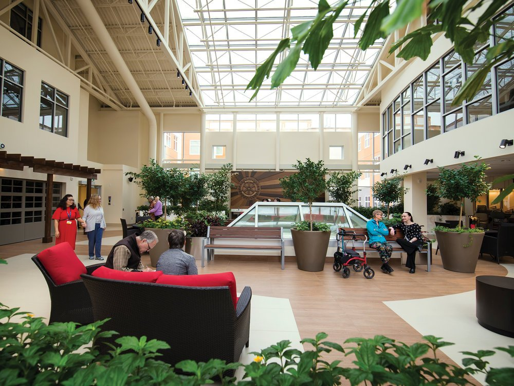 The Rotary Atrium offers 3,000 square feet of space for safe and purposeful wandering. Large windows and plants bring the outdoors in.