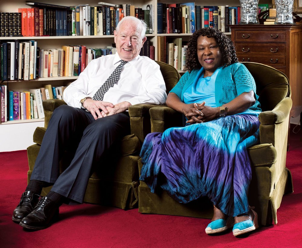 Dr. John Lacey and Vinnette Morgan, who cared for Lacey's wife, Naomi, when she went through dementia. They're pictured here during a visit at Lacey's home.Photo by Jared Sych.