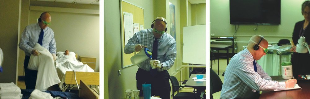 A participant interacts with his environment during a virtual dementia tour. Vision, touch and hearing are altered to simulate the experience of a person living with dementia.