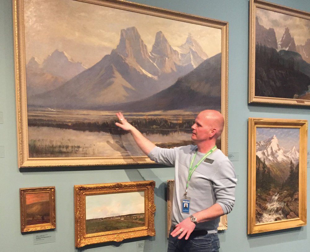 Glenbow educator Ty Larner points out some familiar landscapes to evoke memories during a dementia-friendly guided gallery tour.Photo courtesy Glenbow Museum.