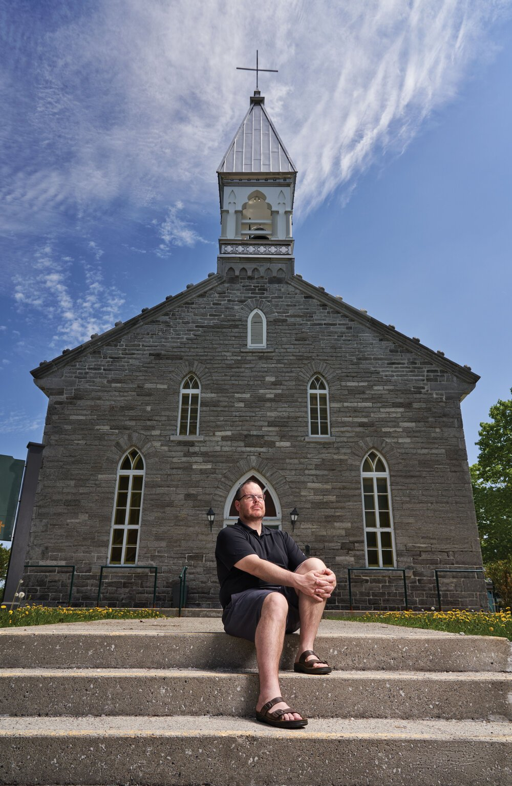 Matthew Dineen outside of the St. Patrick Fallowfield Church in Ottawa. Photo by JVL Photography.