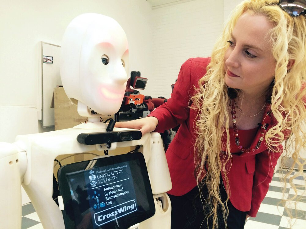 Dr. Goldie Nejat, AGE-WELL investigator and roboticist, at the University of Toronto with Casper the social robot. Photo courtesy of AGE-WELL.
