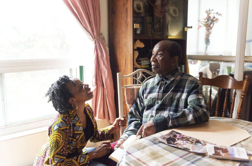 Felix Iroanyah with his daughter, Ngozi, at his home in Mississauga. Photo by Wade Hudson.